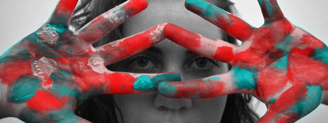 Girl's eyes through colorful hands, image for Ocular Disease Treatment